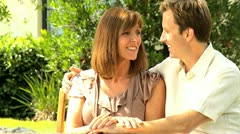 Contented Couple Sitting Home Garden - stock footage