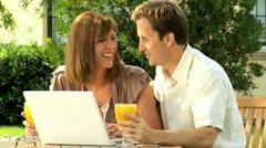Caucasian Couple Using Computer Garden Stock Footage