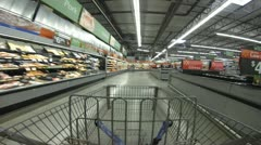 1080p HD Stock Footage - Time lapse in Store - Shopping Cart Wide angle 30p Stock Footage