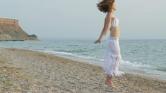 Beautiful woman dancing on the beach Stock Footage