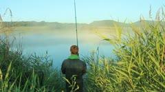 Fisherman On Lake - stock footage