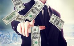 Business man with hundred dollar bills Stock Photos
