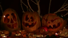 Setting Fire to Candles Inside Pumpkins Stock Footage