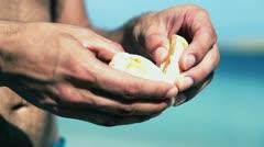 Male hands peeling orange, slow motion shot at 240fps Stock Footage