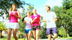 Healthy Family Jogging Together - stock footage