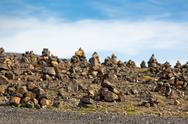 Stock Photo of landscape with pyramids from stones, iceland.