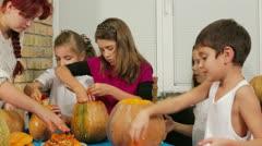 Children Emtying Pumpkins Stock Footage