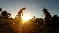 Late afternoon golf chip shot Stock Footage