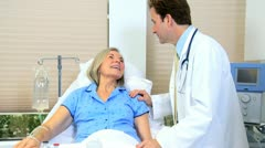 Doctor Treating Senior Female  Patient Stock Footage
