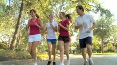 Caucasian Family Jogging Outdoors - stock footage