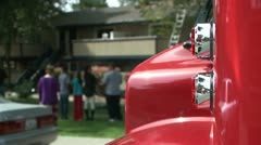 APARTMENT HOUSE FIRE WITH FIRE TRUCK IN THE FOREGROUND FLASHING LIGHTS HD 1080 - stock footage