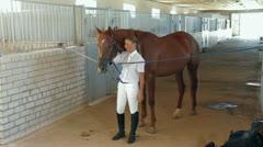 Rider Prepares Saddle Stock Footage