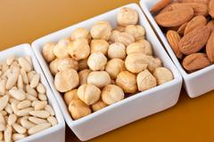Peanuts aldons and hazelnuts Stock Photos