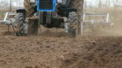 Tractor ploughing the field - stock footage