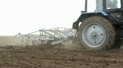 Stock Video Footage of Rural Farmland And Tractor Cultivating
