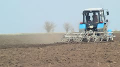 Rural farmland and tractor ploughing - stock footage