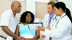 Wireless Tablet Recording Ethnic Patient Medical History Stock Footage