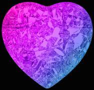 Gradient color diamond heart shape on black Stock Illustration