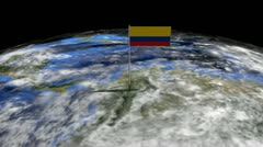 Colombia flag on pole on earth globe animation Stock Footage