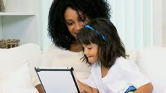 Cute Little Ethnic Girl Playing Tablet Stock Footage
