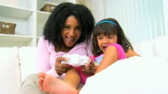 Cute Ethnic Girl Pretty Mom Playing Games Console Stock Footage