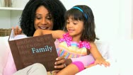 Ethnic Mother Daughter Looking Photographs Stock Footage
