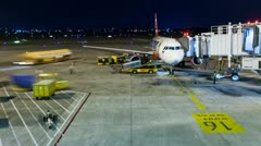 TIMELAPSE - PLANE AT THE AIRPORT TERMINAL Stock Footage