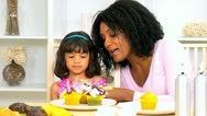 Cute Child Mom Putting Candles on Cakes Stock Footage