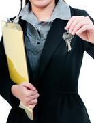 businessperson holding keys - stock photo