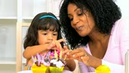 African American Mother Child Decorating Cupcakes Close Up Stock Footage