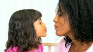 Young Ethnic Mom Daughter Using Lipstick Stock Footage