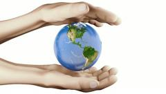 Realistic visualization Earth between hands. Stock Footage