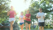 Healthy Family Jogging Together Stock Footage