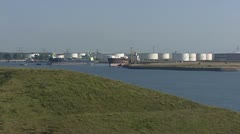 Storage tanks in Port of Rotterdam zoom out canal Calandkanaal Stock Footage