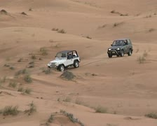 4x4's driving in dunes Stock Footage