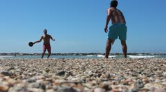 Matkot ball game in Tel Aviv beach Stock Footage