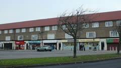 Shops in council estate - pan Stock Footage