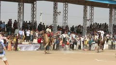 Camel racing at Pushkar camel fair in India Stock Footage