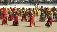 Stock Video Footage of Indian girls in colorful ethnic attire dancing at Pushkar camel fair India