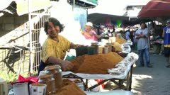 Woman selling sugar at the market in Sibalom in the Republic of the Philippines Stock Footage