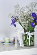 Vase with flowers and complete set of children's ware Stock Photos