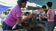 Selling tobacco in a local market in Sibalom in the Republic of the Philippines Stock Footage