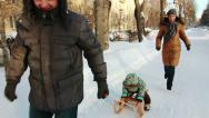 Stock Video Footage of Slow motion shot of father, who is sledging his son.