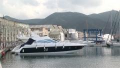 Mini yacht boats docked port-side Stock Footage