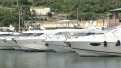 Row of boats docked at port-side Stock Footage