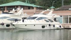 Mini yacht boat docked at port-side Stock Footage