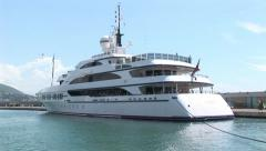 Large yacht docked at port-side Stock Footage