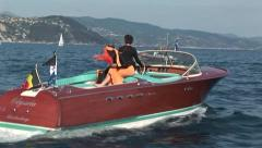 Woman on a Riva motorboat Stock Footage