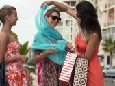 Girlfriends checking their shoppings in the city NTSC Stock Footage