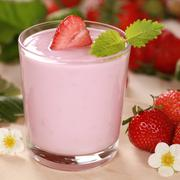 Yogurt with fresh strawberries Stock Photos
